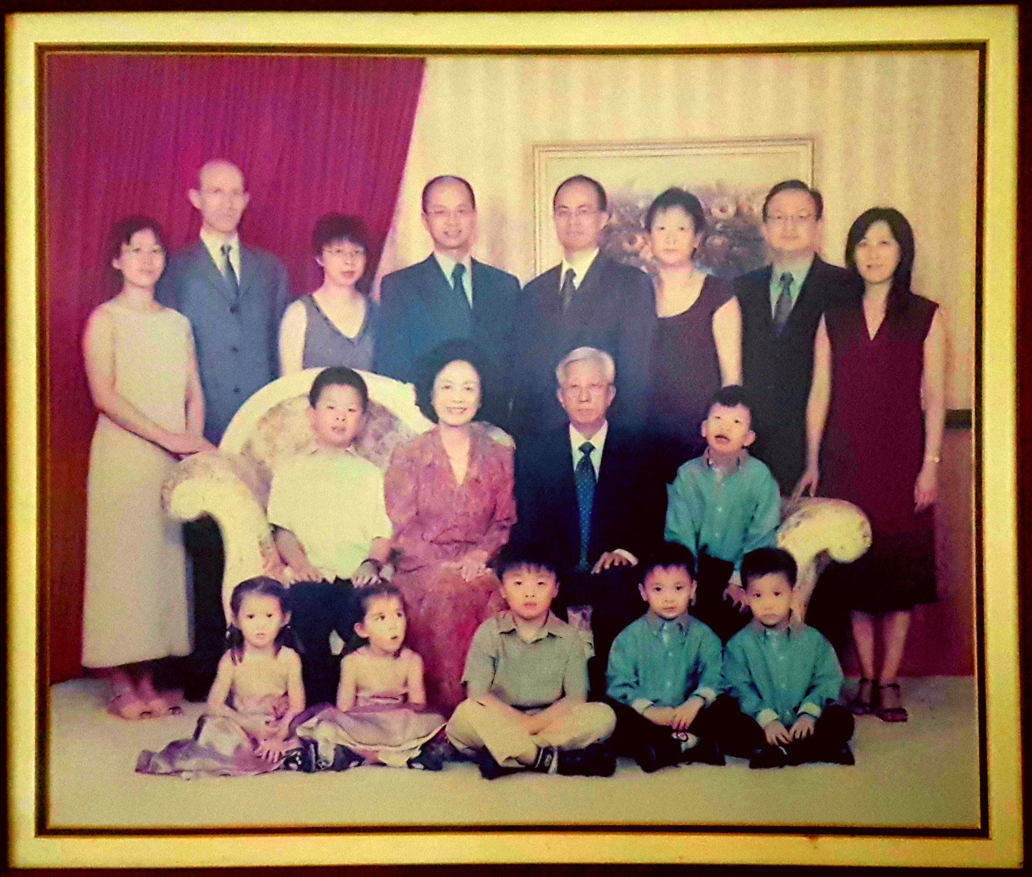 A family picture. I'm directly central in the bottom row, with my paternal grandparents above me.