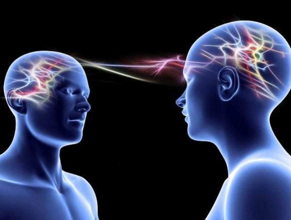 Two humans interfacing with each other.
