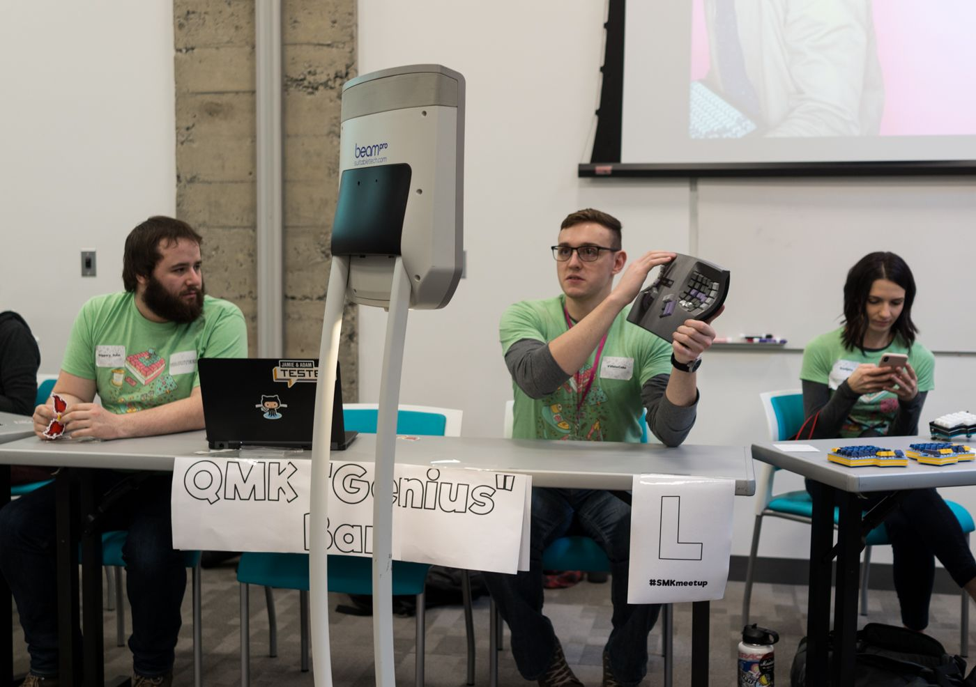 My favorite photo I took at the meetup. There's a comical seriousness to someone holding up a keyboard to show a robot.