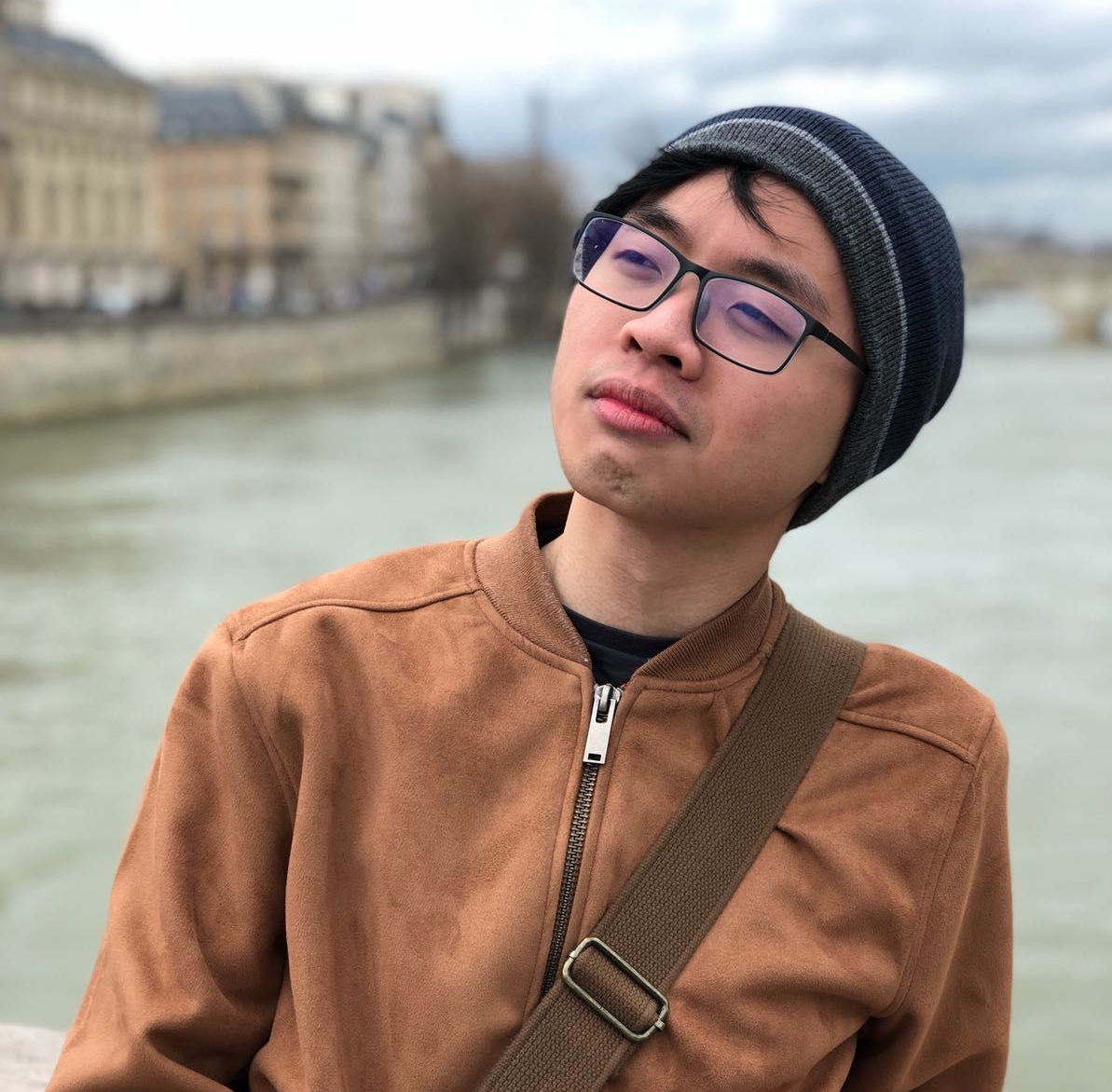 Photographed by the Seine. I'm told I have a recognisable 'thinking face'. This isn't it - it's me being a poser - but I think it's probably quite close?